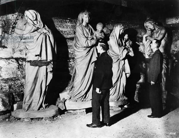 WORLD WAR II: HIDDEN ART Statues hidden in the crypt of Saint-Sulpice in Paris, where they were kept during World War II to keep from being stolen or damaged by air strikes. Photograph, c.1945. Left: Our Lady of Sorrows by Edme Bouchardon, 18th century. Center: Two Virgin Marys by Jean-Baptiste Pigalle, 18th century. Right: Christ at the Pillar, Bouchardon