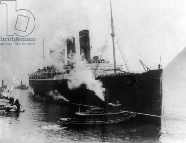 NEW YORK: LUSITANIA, 1914 The Cunard steamship 'Lusitania' at New York Harbor, 6 March 1914.