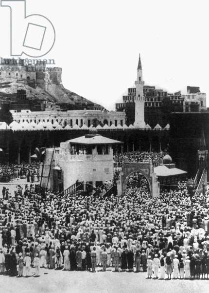 KA'BA AT MECCA. Muslim pilgrims worhipping the sacred shrine of Islam in the courtyard of Masjid al-Haram (Sacred Mosque) at Mecca, Saudi Arabia. Stereograph, c.1885.