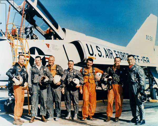SPACE: ASTRONAUTS, c.1961 The original seven astronauts of the Mercury Program. Left the right: Scott Carpenter, Gordon Cooper, John Glenn, Virgil 'Gus' Grissom, Walter Schirra, Alan Shepard and Donald Slayton. Photographed in front of a Convair F-106 plane, c.1961.