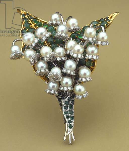 VERDURA: PIN, 1970 Lily-of-the-valley pin made of emeralds, diamonds, and pearls. Made by Fulco di Verdura, 1970.