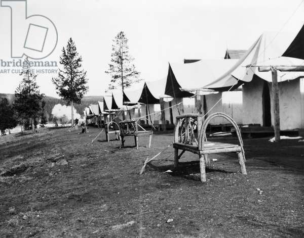 TOURIST LODGING, 1903 The tourist tents and rustic log benches in upper Geyser Basin, Yellowstone National Park, Wyoming. Photograph by Frances Benjamin Johnston, 1903.