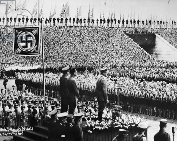 NUREMBERG RALLY, 1938 Adolf Hitler addressing a crowd of Hitler Youth at the annual rally in Nuremberg, Germany. Photograph, 1938.
