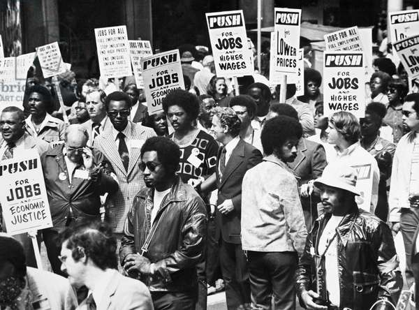 JESSE JACKSON (1941- ) American civil rights leader. Jackson (center, without jacket) at an Operation PUSH (People United to Save Humanity) demonstration for jobs and higher wages, Chicago, Illinois, 1973.