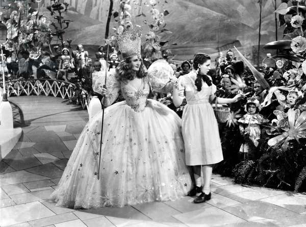 WIZARD OF OZ, 1939 Billie Burke as Glinda, the Good Witch of the North, and Judy Garland as Dorothy, in a scene from the film 'The Wizard of Oz,' 1939.