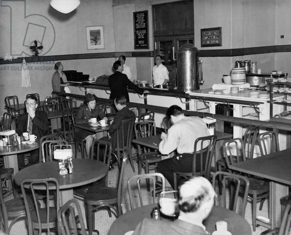 ELLIS ISLAND: CAFETERIA Employees' cafeteria at the immigration station in New York Harbor during World War II, c.1944,