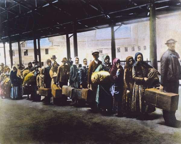 EUROPEAN IMMIGRANTS Immigrants at Ellis Island. Oil over a photograph, c.1900.