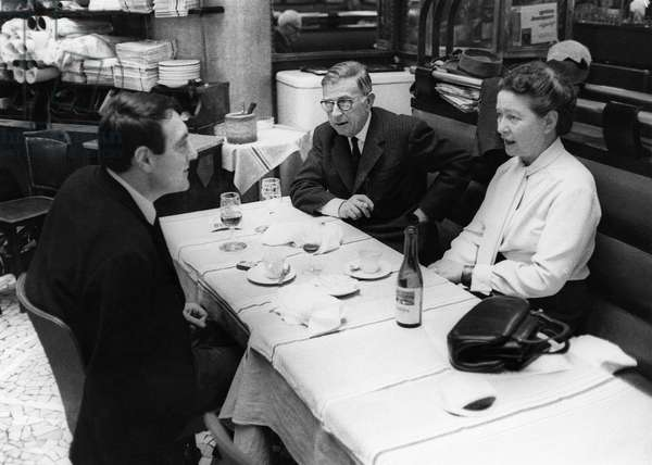 SARTRE & BEAUVOIR, 1964 French philosopher Jean-Paul Sartre and writer Simone Beauvoir having lunch at a cafe in Paris, 1964.