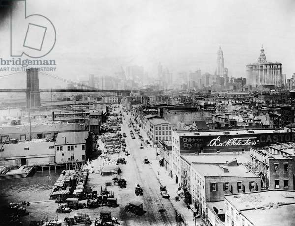 NEW YORK: SOUTH STREET Bird's-eye view of South Street, New York City, showing the Brooklyn Bridge, the Woolworth and Municipal buildings in the background. Photograph, c.1917.
