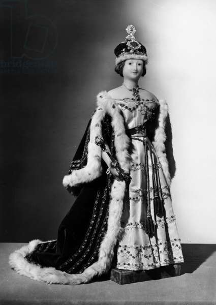 QUEEN VICTORIA: WAX DOLL Wax model of Queen Victoria in her coronation robes, English, c.1840. Height: 20.5 inches.