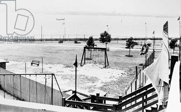ELLIS ISLAND: DETAINEES Athletic field for foreign enemy detainees held at Ellis Island during and after World War II. Photograph, c.1945.