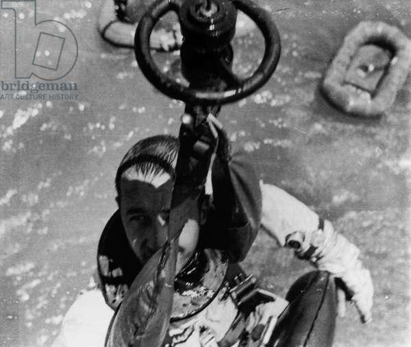 GEMINI 4: JAMES McDIVITT Astronaut James McDivitt, command pilot on the Gemini 4 is hoised aboard a helicopter after landing in the Atlantic Ocean, 1965.