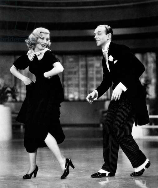 ASTAIRE & ROGERS, 1936 Fred Astaire with Ginger Rogers in 'Swing Time,' 1936.