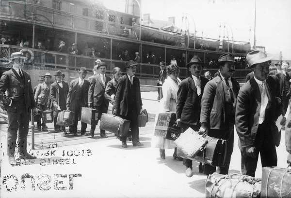IMMIGRANTS, 1920 European immigrants leaving the Ellis Island ferry to arive in the United States, 1920.