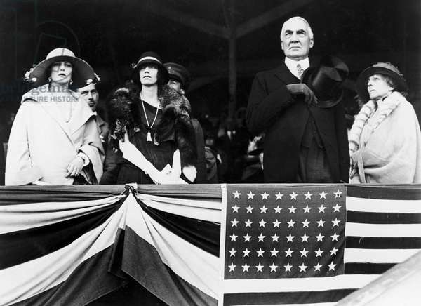 WARREN G. HARDING (1865-1923). 29th President of the United States. President and Mrs. Florence Harding (wearing fox) at a horse show, May 1923.