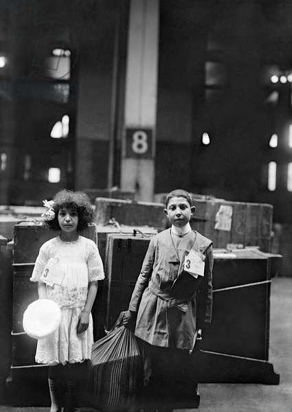 ELLIS ISLAND, c.1910 Immigrant children at Ellis Island. Photograph, c.1910.