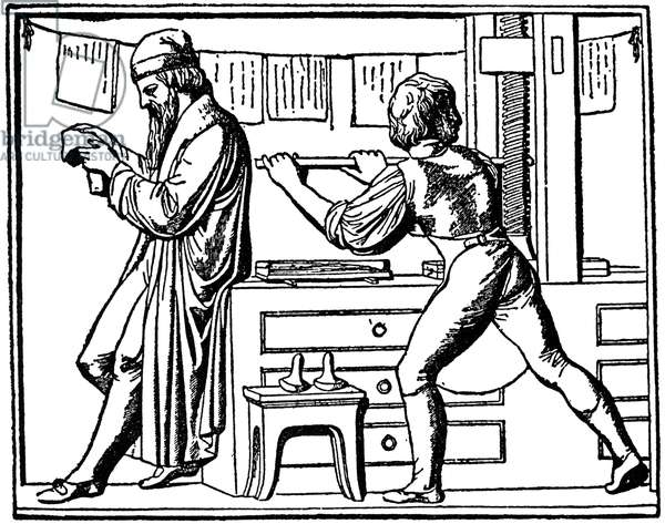 JOHANN GUTENBERG (1400?-1468). German printer. Gutenberg examining a proof. Engraved after a bas-relief on the pedestal of the Gutenberg monument at Mainz, Germany.