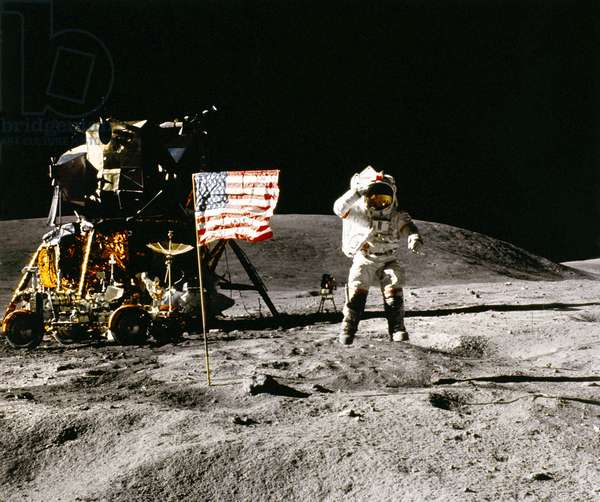 APOLLO 16: LANDING, 1972 Astronaut John Young saluting the American flag on the moon. Photograph by Charles Duke, 1972.