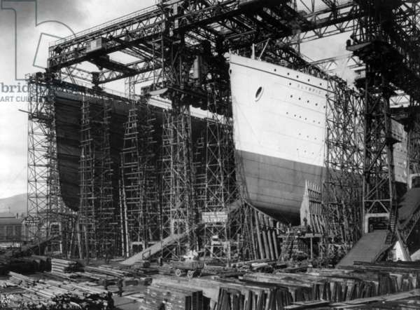 TITANIC: CONSTRUCTION, c.1910 View of the 'Olympic' (left) and 'Titanic' under construction at the Harland & Wolff shipyards, Belfast, Ireland. Photographed c.1910.