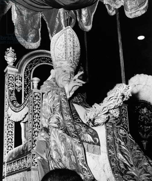 JOHN XXIII (1881-1963) Pope, 1958-1963. Blessing the crowd in St. Peter's Basilica in Rome on Palm Sunday, 15 April 1962.