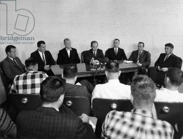 SPACE: ASTRONAUTS, 1961 Six of the Mercury Seven astronauts at a press conference, the day after the launch of the Mercury-Atlas 2 mission. Left to right: Leroy Cooper Jr., Donald 'Deke' Slayton, John Glenn, John Powers, Alan Shepard Jr., Scott Carpenter, and Walter 'Wally' Schirra. Photograph, 22 February 1961.