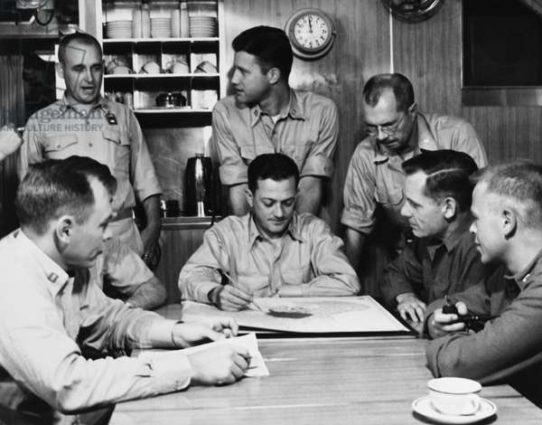 NAVY: USS NAUTILUS, 1958 Commanding officer W.R. Anderson of the USS Nautilus briefing officers on the submarine's voyage to the North Pole. Photograph, 1958.