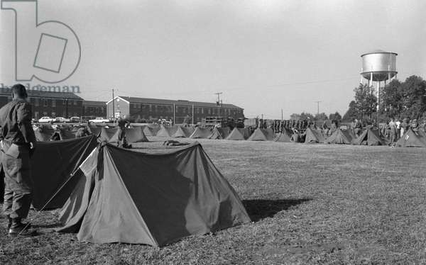 INTEGRATION: OLE MISS, 1962 Soldiers and tents across from Baxter Hall where James Meredith, the first black student, lived at the University of Mississippi, Oxford, Mississippi. Photograph, Marion S. Trikosko, 4 October 1962.