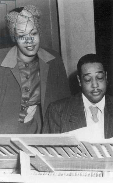 DUKE ELLINGTON (1899-1974) American bandleader and composer. Ellington with Billie Holiday (1915-1959), c.1950.