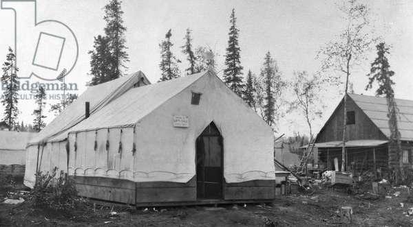 ALASKA: ANCHORAGE, c.1910 Tents and log cabins in Anchorage, Alaska, c.1910.
