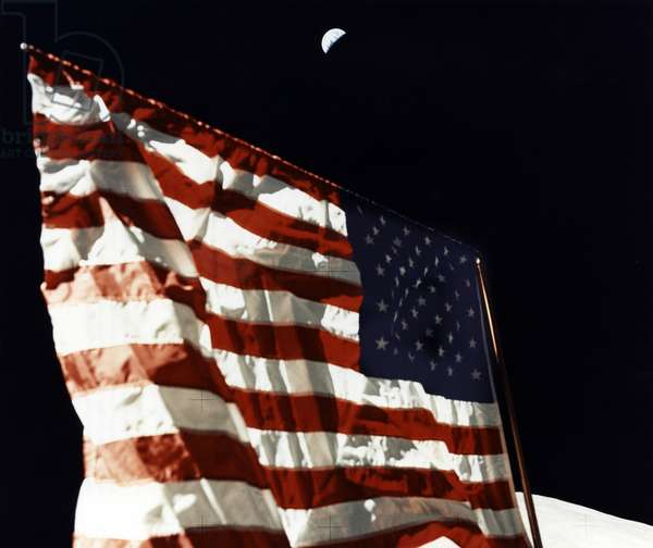 APOLLO 17 LANDING, 1972 A view of the American flag planted by the Apollo 17 astronauts on the surface of the moon. Photograph, 1972.