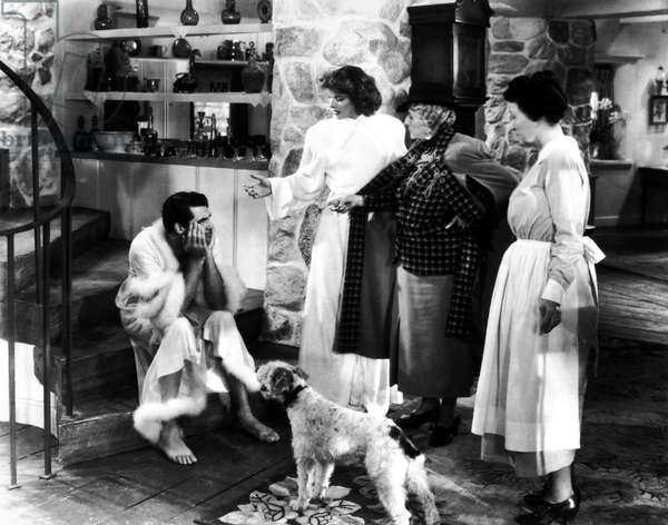 BRINGING UP BABY, 1938 Katharine Hepburn (center) and Cary Grant (left) in a scene from the film 'Bringing Up Baby,' directed by Howard Hawks, 1938.