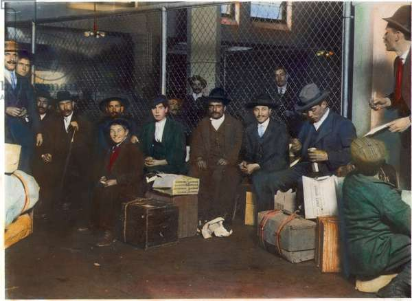 IMMIGRANTS: ELLIS ISLAND A group of Italian men and boys at Ellis Island: photographed in 1905 by Lewis W. Hine.