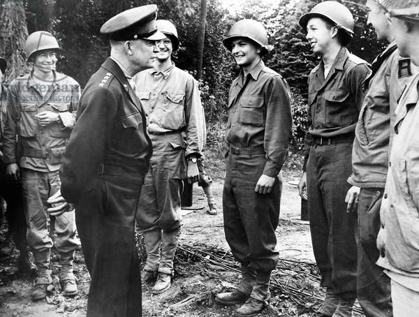 DWIGHT D. EISENHOWER (1890-1969). 34th President of the United States. Eisenhower pausing to talk to soldiers in France, 26 July 1944.
