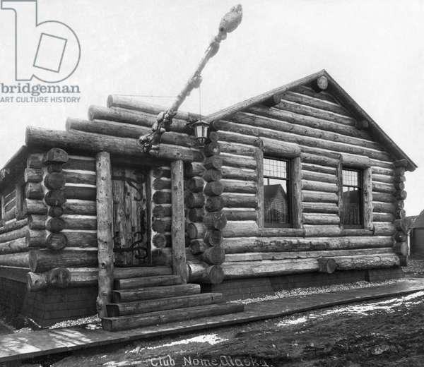 ALASKA: LOG CABIN, c.1916 The Log Cabin Clubhouse in Nome, Alaska. Photograph, c.1916.