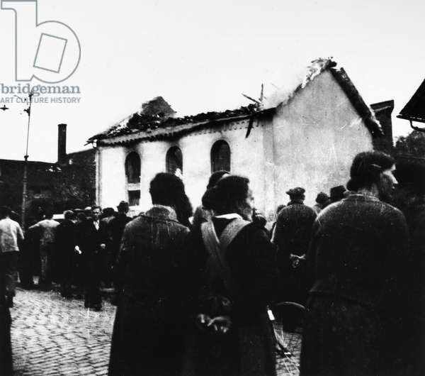 KRISTALLNACHT, 1938 Residents of Ober-Ramstadt, Germany, gather outside the burned ruins of the local synagogue in the aftermath of the Kristallnacht pogrom, 9-10 November 1938.