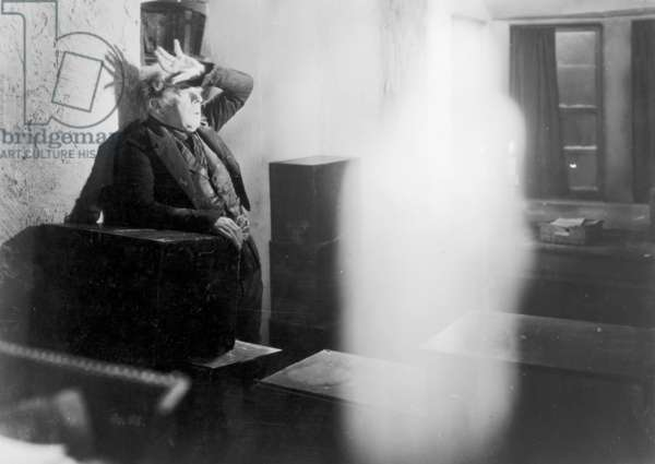 FILM STILL: GHOSTS. A scene from 'Scrooge' an early film adaptation of Charles Dickens' 'A Christmas Carol'.