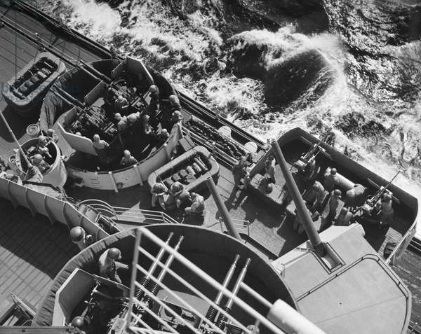 KOREAN WAR: BATTLESHIP Men of the battleship U.S.S. 'Wisconsin' man their battle stations off the coast of Korea. Photographed 1952.