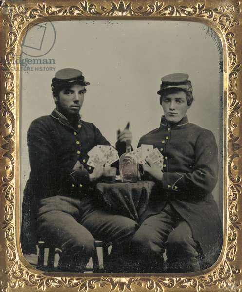 CIVIL WAR: SOLDIERS, c.1863 Union soldiers playing cards and drinking whiskey. Tintype, c.1863.