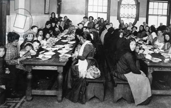 ELLIS ISLAND, c.1906 Immigrant women and children having a meal in the dining room at Ellis Island. Photograph, c.1906.