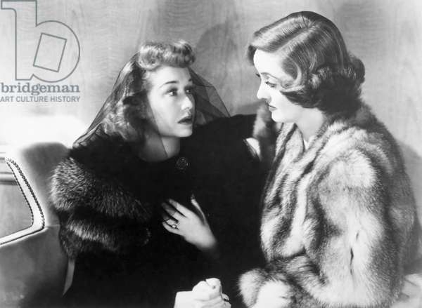 BETTE DAVIS (1908-1989) Bette Davis and Miriam Hopkins in the film 'Old Acquaintance,' 1943.