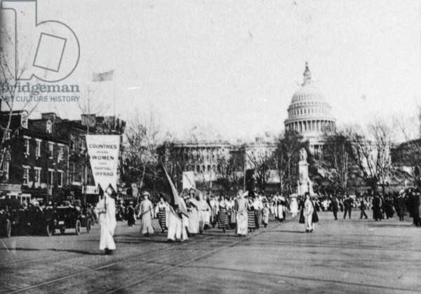 SUFFRAGE PARADE, 1913 Marchers carrying a banner reading 'Countries Where Women Have Partial Suffrage.' Photographed outside the Capitol building in Washington, D.C., March 1913.