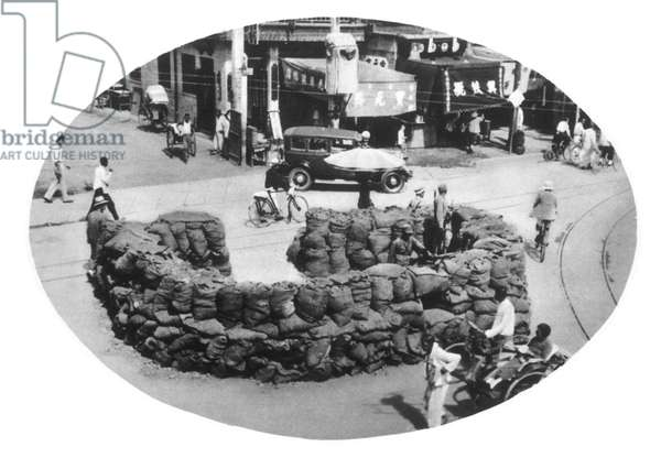 CHINA: JAPANESE INVASION A machine-gun post in Beijing protected by sandbags, July 1937.