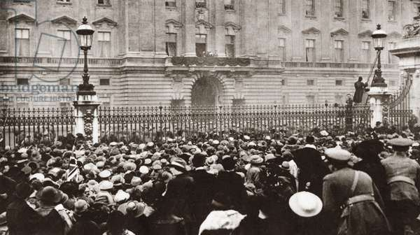 WORLD WAR I: CELEBRATION Crowd in front of Buckingham Palace celebrating the signing of the Armistice and cheering King George V who appeared on the balcony in London, England. Photograph, November 11, 1918.