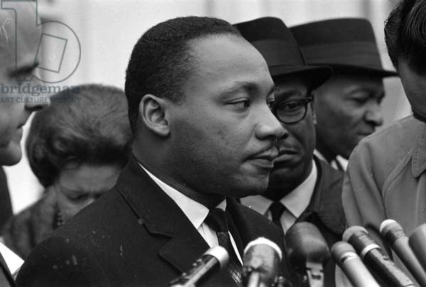 MARTIN LUTHER KING, JR (1929-1968). American cleric and civil rights leader. After a meeting at the White House. Photograph by Warren K. Leffler, 1963.