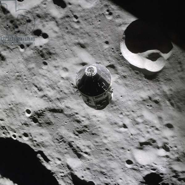 APOLLO 16, 1972 The Apollo 16 Command and Service Modules and lunar surface, as seen from the Lunar Module. Photograph, 20 April 1972.