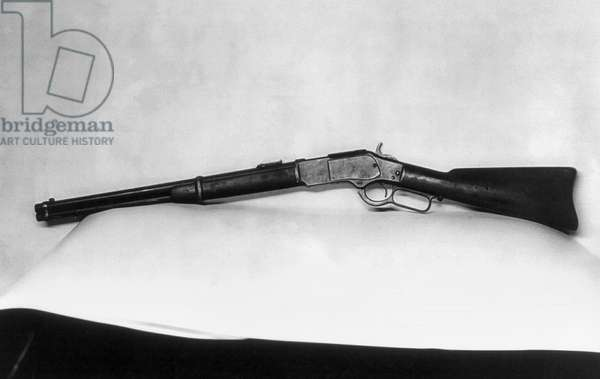 JESSE JAMES (1847-1882) A Winchester rifle owned by Jesse James. Photograph, c.1921.