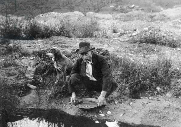 ALASKA: MINING, 1916 A miner panning for gold in Alaska. Photograph, 1916.