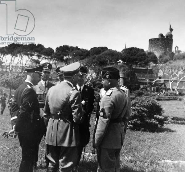 HITLER AND MUSSOLINI, c.1938 German Chancellor Adolf Hitler (center) and Italian Prime Minister Benito Mussolini (right) with Rudolf Hess and Heinrich Himmler, visiting Santa Marinella, Italy. Photograph by Heinrich Hoffmann, c.1938.