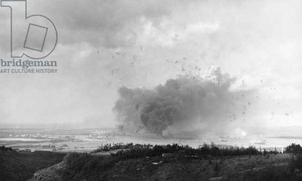 WORLD WAR II: PEARL HARBOR Burning and damaged ships at Pearl Harbor, Hawaii, during the Japanese air raid, 7 December 1941.