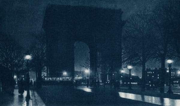 FRANCE: PARIS, c.1920 The Arc de Triomphe at night. Photograph, c.1920.